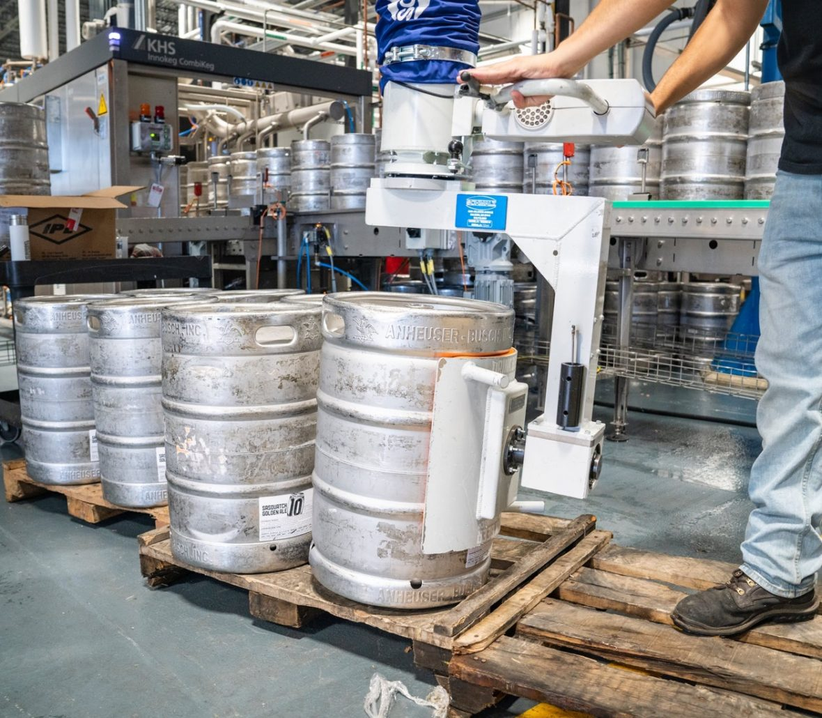 Brewer on forklift moving kegs