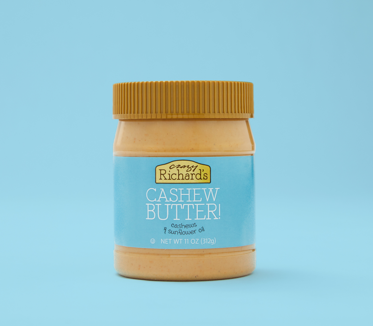 Crazy Richard's cashew butter on blue background