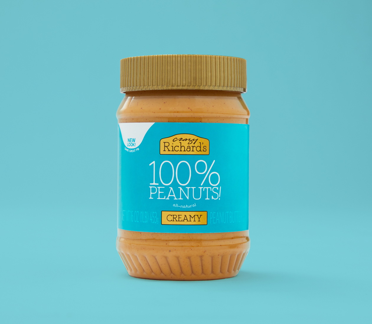 Crazy Richard's Creamy Peanut Butter on teal background